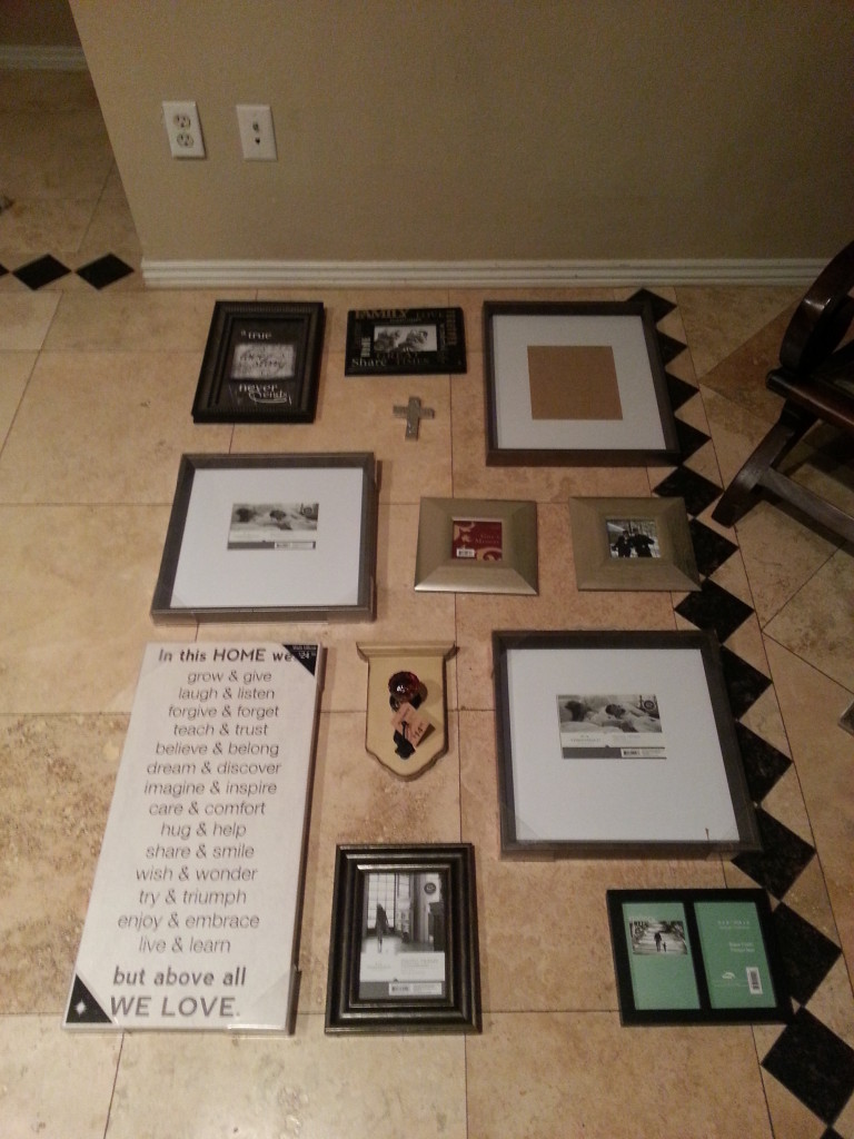 Arranging the Photo Wall before hanging it.